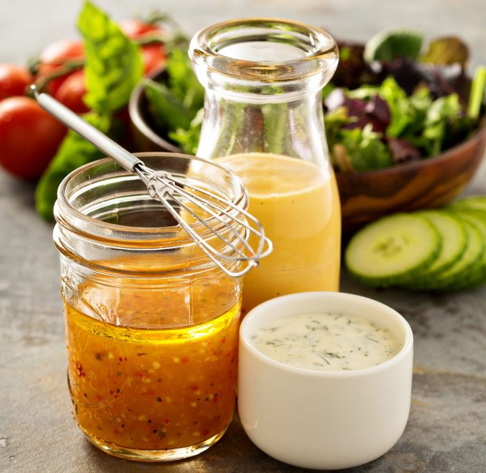 Variety of homemade sauces and salad dressings in jars